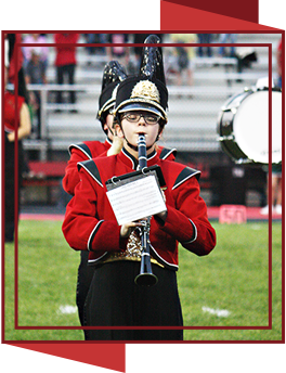 girl in band uniform playing the clarinet