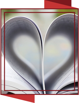Open book with pages folded into the shape of a heart