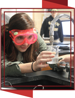 Student wearing goggles in science class
