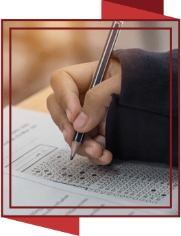 Student hand filling in bubble on test paper