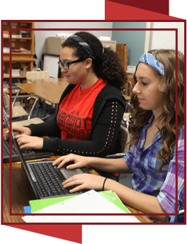 Two female students using laptop computers