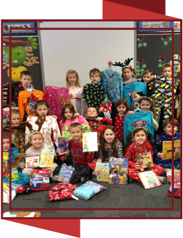 Students dressed in pajamas holding books