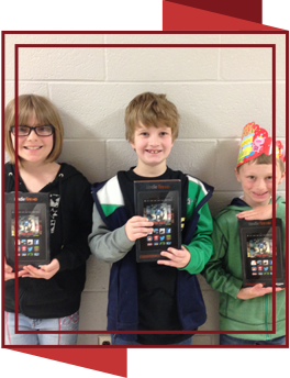Students holding Kindle Fire tablets