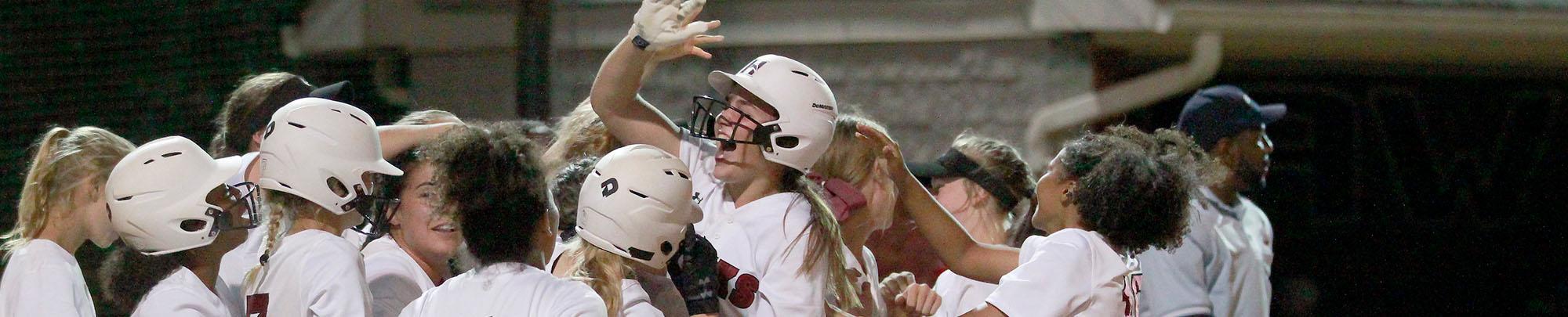 Girls softball team huddling up during a game