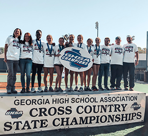 2019 GHSA 7A girls cross country state champions pose together