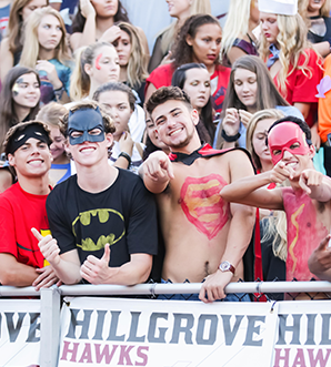 Group of Hillgrove Hawks in spirit masks at football game