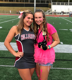 Hillgrove cheerleader with student school photographer