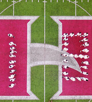 Arial view of football players making the number 18 on the football field