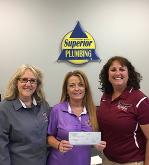 Superior Plumbing representative making a donation to Hillgrove