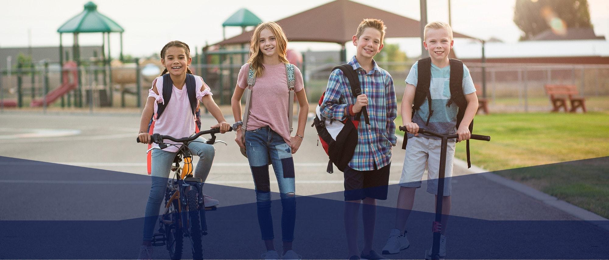 Kids sitting on bikes