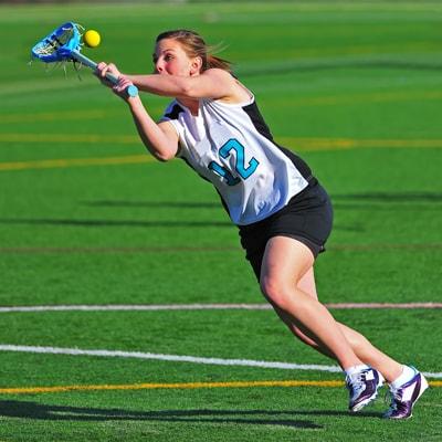 girl playing lacrosse
