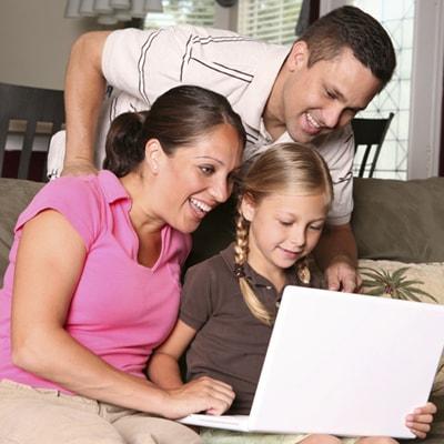 family around a laptop