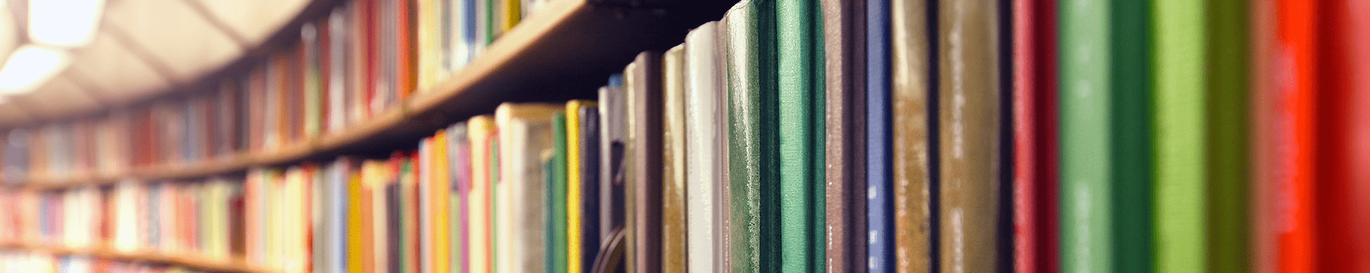 Shelves of colorful books from inside a library