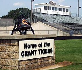 Home of the Grant Tigers sign in front of our football field