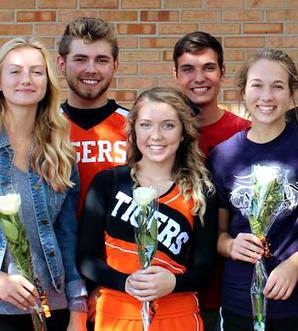 students smiling at the camera