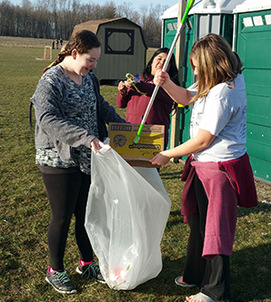 Students pick up trash as part of a community service event