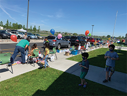 Students and staff participate in the end of school parade