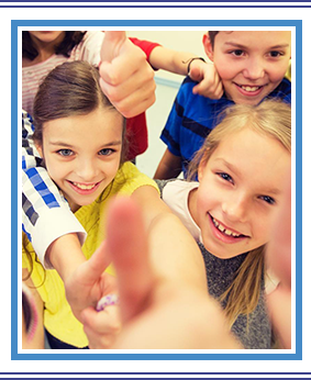 Group of school kids showing thumbs up in the classroom