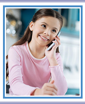 Beautiful cheerful dark-eyed girl smiling and talking on the phone