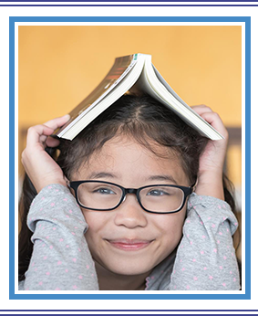 World book day concept with happy school student girl with eye glasses and book on head