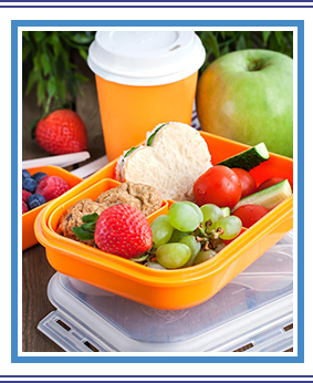 Lunch box with sandwich, cookies, and veggies and fruits