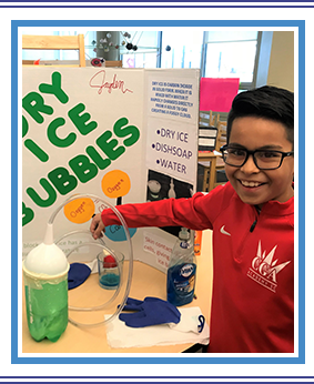 Student happily presenting his DRY ICE BUBBLES project