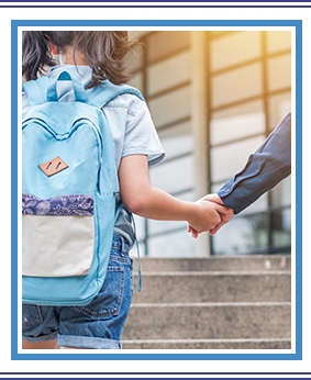 Elementary school girl with backpack walking to school with parent