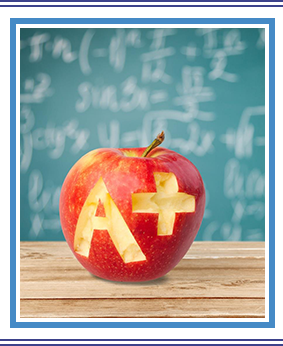 Letter A+ engraved on an apple on top of a wood table