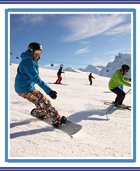 Smiling Monticello Montessori student on a ski board going down the mountain