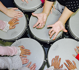 students hands on drums