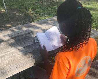 Faxon scholar focused on reading her book