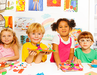 Kids posing with art projects