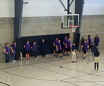 Hermiston students playing basketball in the gym