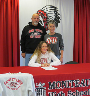 Baily Trettel and family at signing table