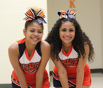 Two smiling Warrior cheerleaders