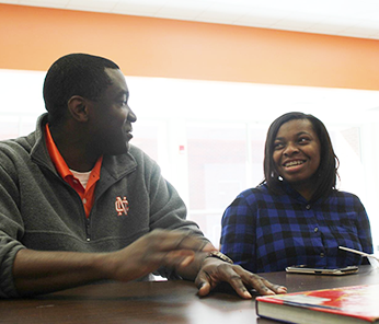 North Cobb staff member talking with a student in a classroom