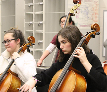Two female students playing the cello