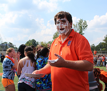 North Cobb staff member with a whipped cream pie in the face