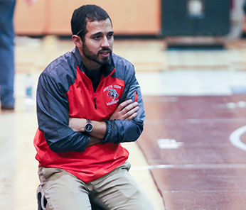 North Cobb Warrior coach sitting on the basketball court floor