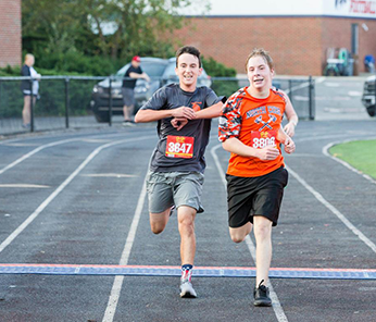 Two students challenging each other in a race