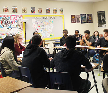 Group of students in a classroom having a discussion