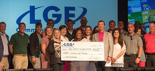 Members of the LGE Community Credit Union and the Cobb County School District stand together holding a large check for 16,000 dollars for a 2018 partnership