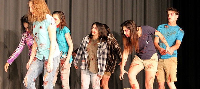 Students in play dressed as zombies