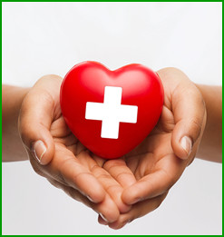 Hands hold a heart with a nurse cross in the center