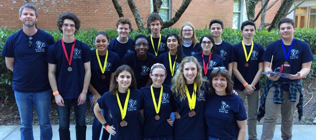 Group of Harrison High School students with medal awards