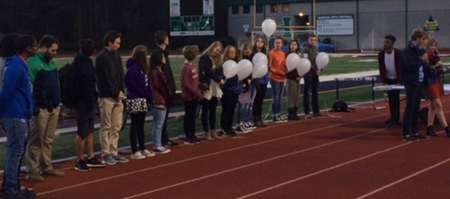 Harrison High School students on track with balloons