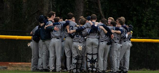 Boys baseball team in a huddle