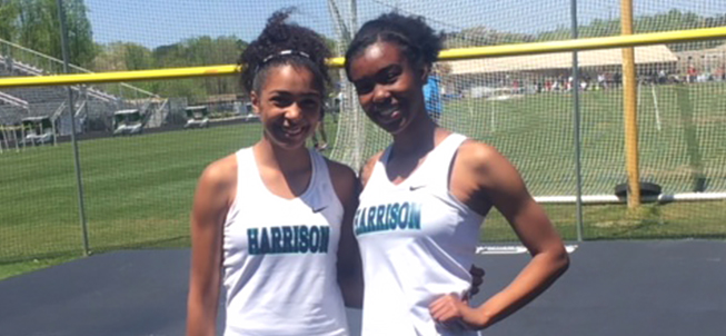 Harrison High School Athletes Smiling in Grassy Field