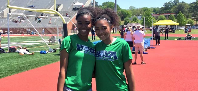 Two smiling Track and Field athletes