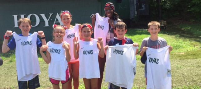 Group of Harrison students holding Hoyas shirts